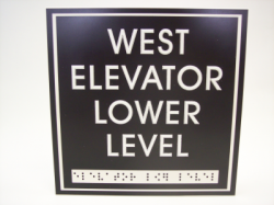 west elevator lower level A.D.A sign